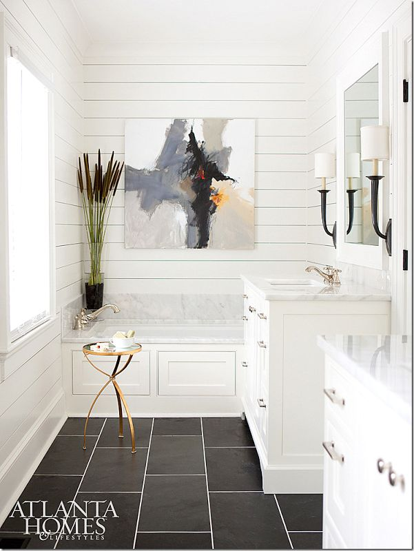 I like the use of the black floor and the black wall sconces. The 'ship lap' walls and the abstract piece of art.