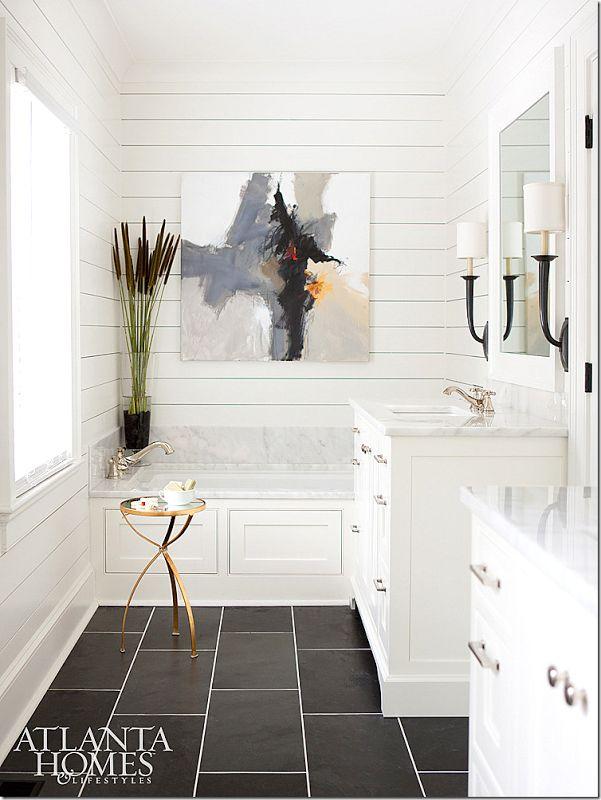 Flooring tile is Black Blizzard slate. Counters, backsplash are polished Avalon marble from Turkey