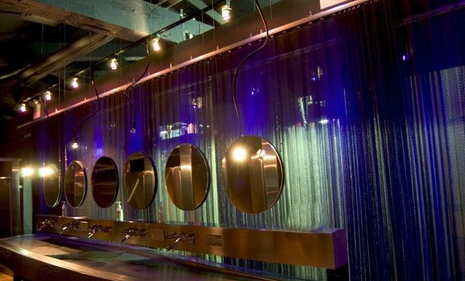 The Crobar in New York exhibits the semi transparent color projection upon Cascade Coil metal mesh drapery.