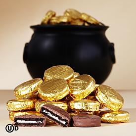I could do this- wrap cookies in gold foil! Great pot o gold  cheaper than chocolate coins! Pirate Party gold doubloons