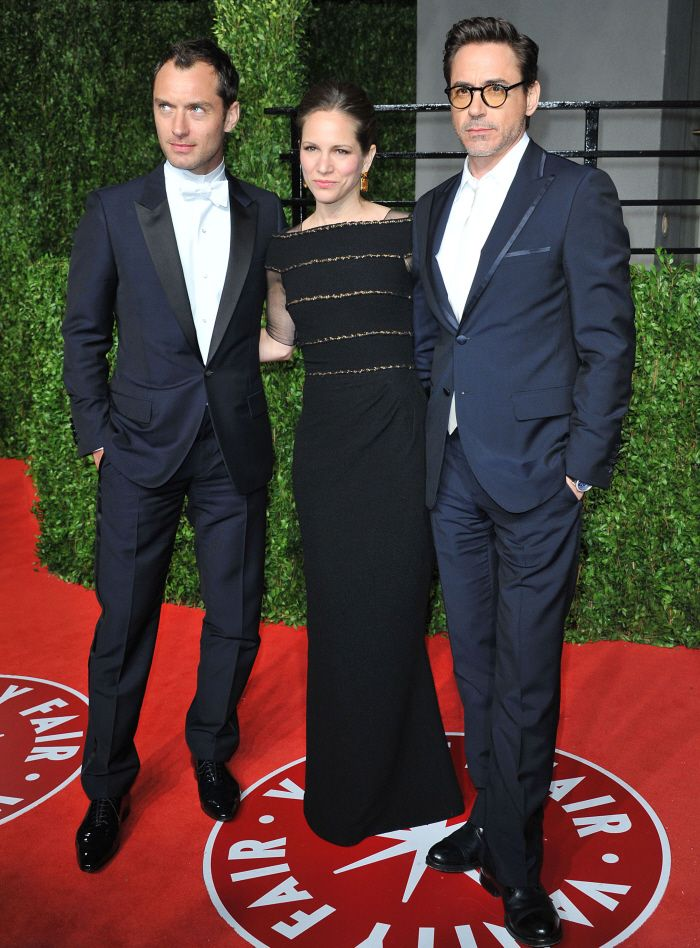 Jude Law, Susan Downey and Robert Downey Jr. at the 2010 Vanity Fair Oscars party.
