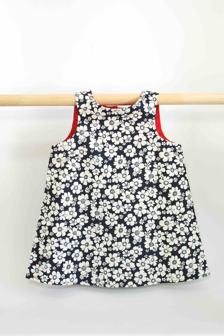 Blue Floral Dress with Red Lining: This super cute summer dress not only looks great on kids but is also comfortable to wear and easy to clean, making it perfect for all occasions and still allowing a kid to be a kid.