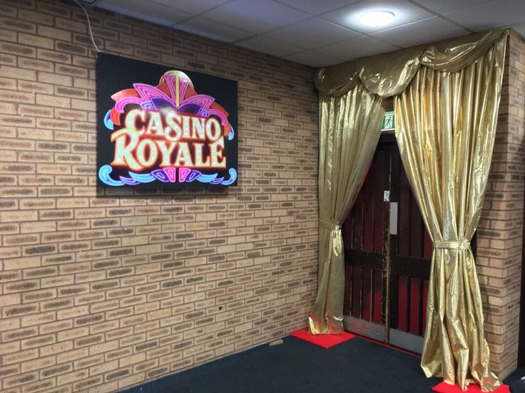 Luxury gold curtains and a Casino Royale themed TV screen to welcome guests into the party