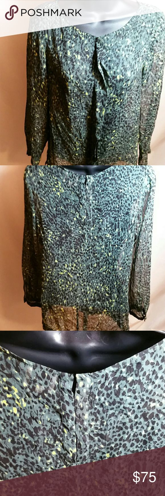 """NWOT Reiss Gray Leopard Silk Blouse Sz 2 NWOT Reiss Greenish Gray Leopard Silk Blouse Sz 2 Dress like a princess bought at a sample sale. Silk is green yellow and black. Hook and eyes on back to close. 3"""" slit on each side.  Covered buttons on sleeves. 36"""" chest, 24"""" long from shoulder. 16"""" between shoulders and sleeves are 21"""" long. Made in China of 100% silk. Dry Clean Only. The top is sheer. Reiss Tops Blouses"""