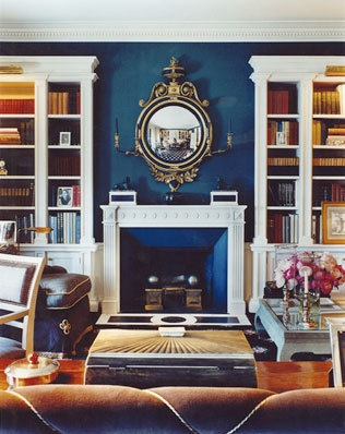 wall color, navy blue love a leather couch with the rich blue walls and white built ins!  Great idea for the living room.
