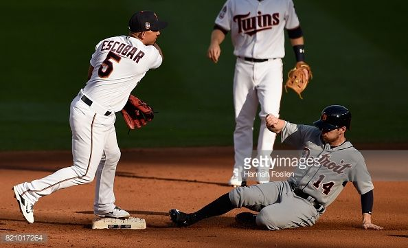 News Photo : Alex Presley of the Detroit Tigers is out at...