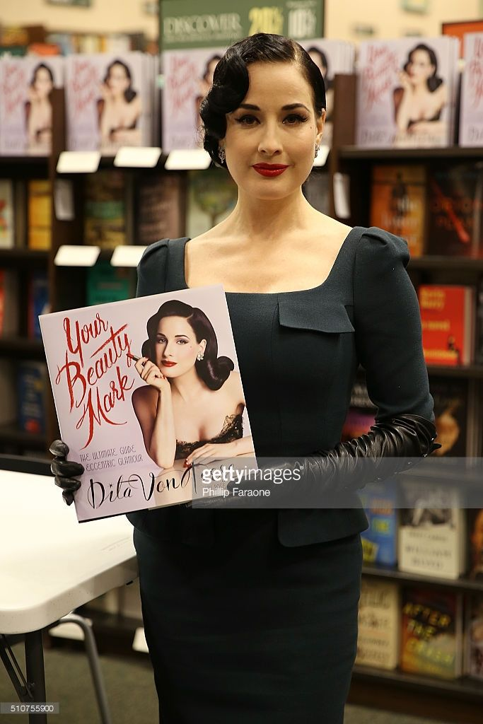 Dita Von Teese signs copies of her new book 'Your Beauty Mark: The Ultimate Guide To Eccentric Glamour' at Barnes & Noble on February 16, 2016 in Huntington Beach, California.