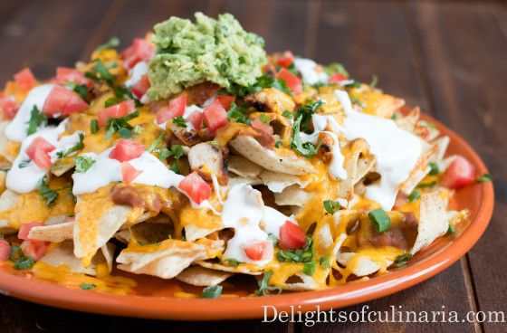 It won't take a long time for these Grande Nachos to become your family favorite.A large platter of crisp tortilla chips loaded with seasoned chicken,hearty beans,cheese,tomatoes,sour cream and green onion. And to elevate it to a more SUPREME level, Add some fresh guacamole,jalapeño and cilantro. This recipe was inspired by my awesome sister Dasha. She …