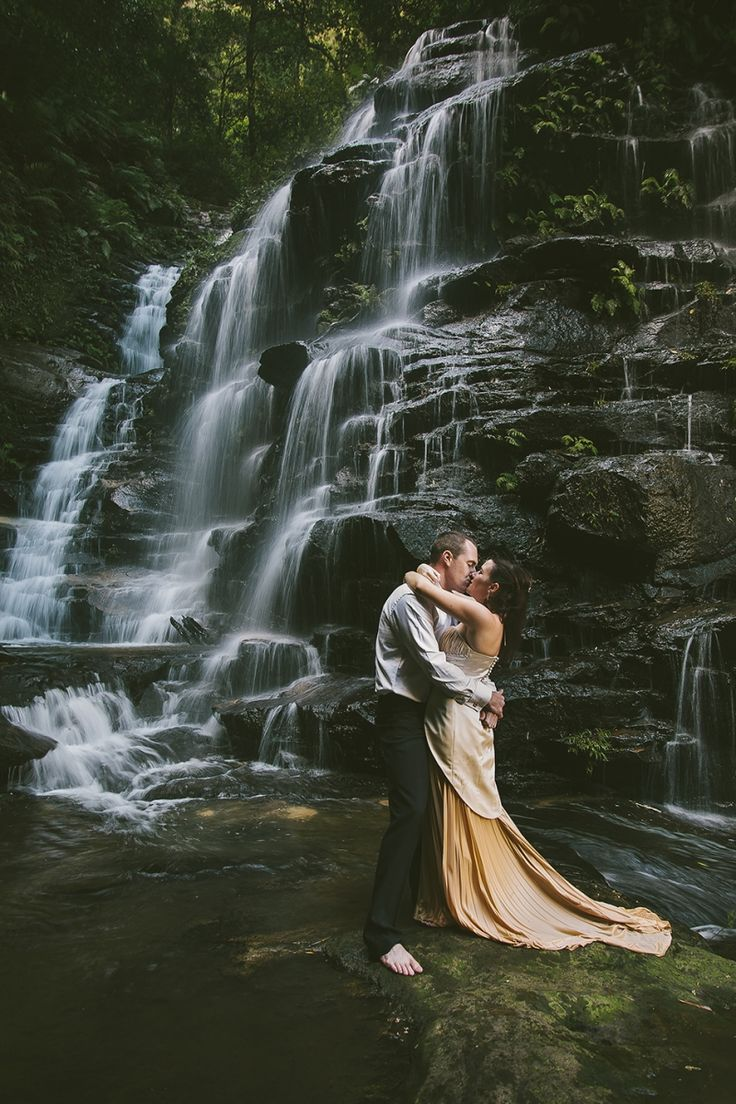 Trash the dress photography ideas. Dramatic waterfall drown the gown. Image: Cavanagh Photography http://cavanaghphotography.com.au
