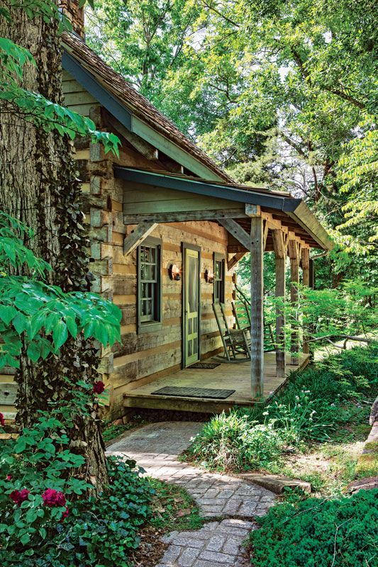 Love this!!!  A Cozy Cabin with a Rustic Feel This outdoorsy Tennessee home – designed to look like it was built in the 1850s – might be a cozy cabin, but it lives large. Story by Nancy E. Oates Photos by Roger Wade, courtesy Hearthstone Homes Styling by Debra Grahl
