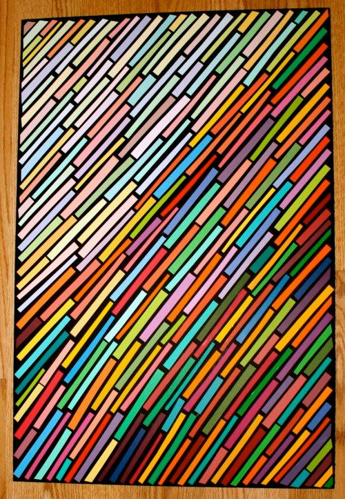 paint chips on black paper