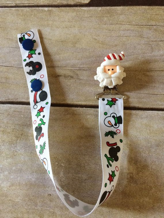 This is a Christmas Mickey and Santa pacifier clip. Great for Christmas. There is only one so be sure to grab it before its gone!! The flat, lead