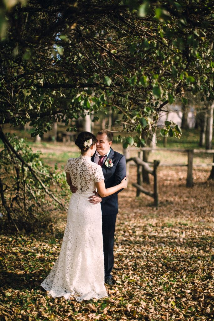 the bride and groom in autumn Park