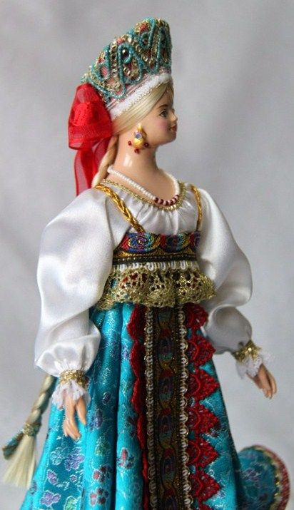 A doll in the Russian traditional costume.