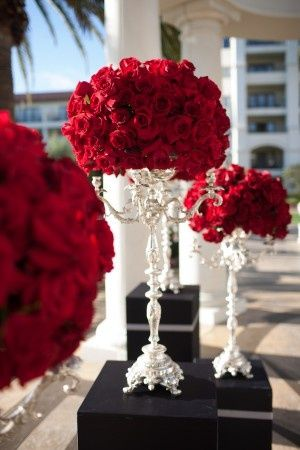 Rose Balls on Candlesticks | Carnations a less expensive flower than Roses and just as impactful.
