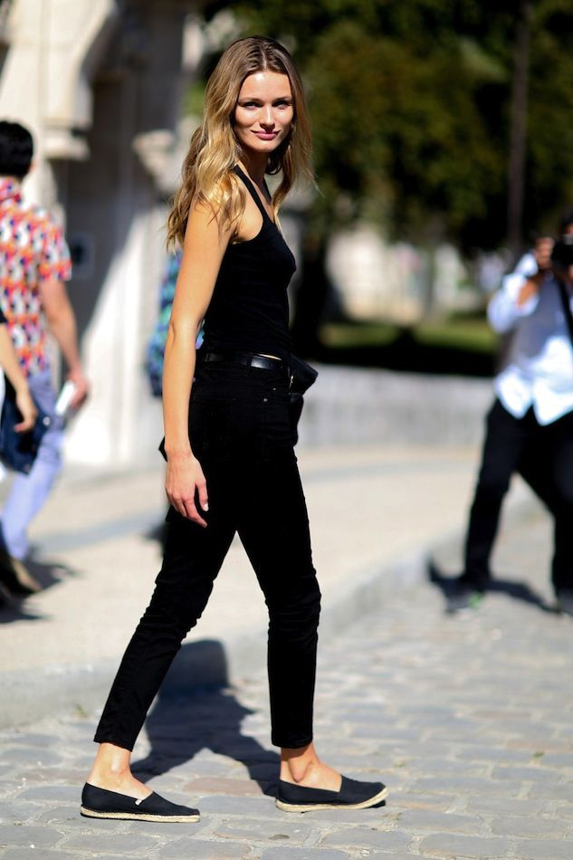 Edita Vilkeviciute // long wavy hair, black tank top, leather belt, cropped black jeans & espadrilles