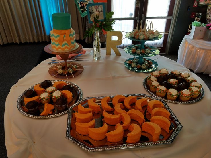 Jennifer and Doug's Miami Dolphins themed wedding also included their wedding cake and desserts for their guests.