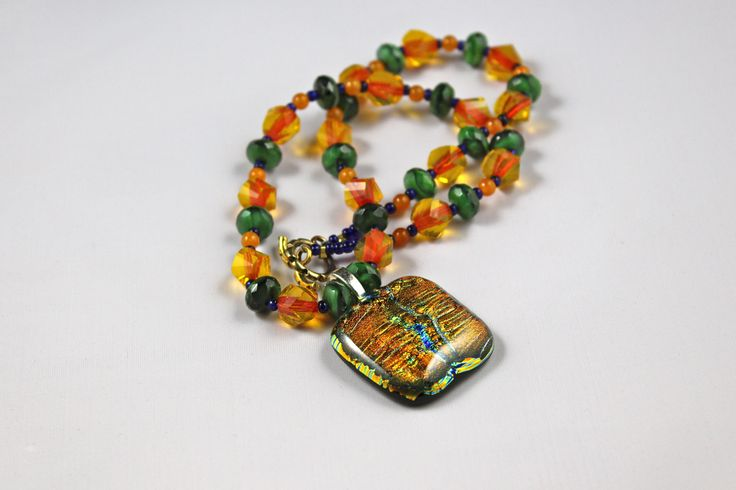 A sparkling trending amber and moss green pendant necklace. It is one of my beautiful piece of jewelry. http://www.buybeadednecklaceonline.com
