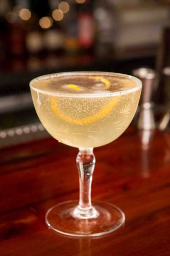 5 Speakeasy Cocktails...And Their Shady Pasts #refinery29  http://www.refinery29.com/46674#slide3  French 75  Created at Harry's Bar in Paris and popularized by The Stork Club in NYC, this cocktail got its name from its potency. Sippers claimed it had the kick of a French 75mm field gun. (Ed. Note: lightweights!)  1.25 oz Tanqueray Ten 0.5 oz simple syrup 0.5 oz lemon juice Top with Champagne  Shake and strain into a rocks glass and top with Champagne.    Photo: Courtesy of Tanqueray