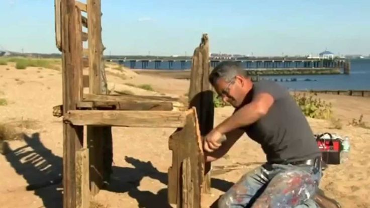Artist Scott LoBaido creates 24 chairs to remember the 24 lives lost in Staten Island during Superstorm Sandy three years ago. Display (no reporter narration...