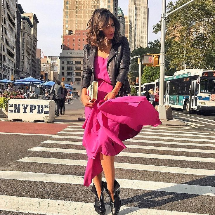 Leather jacket and pink dress for NYFW style.