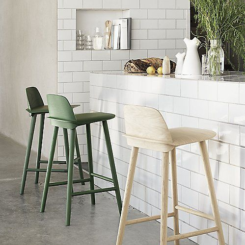 Are you a geek for great modern design? Then the Muuto Nerd Barstool is the perfect piece for you. It is a new take on classic molded plywood furniture, with a curved oak or ash wood back slotted through the seat before being attached to the long solid wood legs. The final effect is at once sleek, sturdy and comfortable.
