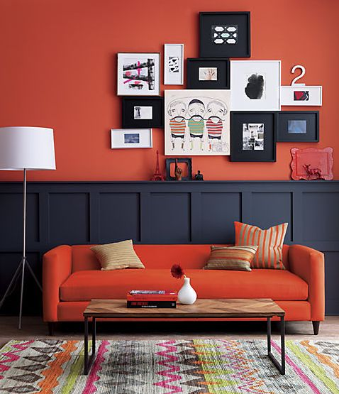 Red wall and sofa living room. Love how the art pops over that bold color wall. Looking for unique art photos and porter prints to create your gallery wall? Visit bx3foto.etsy.com