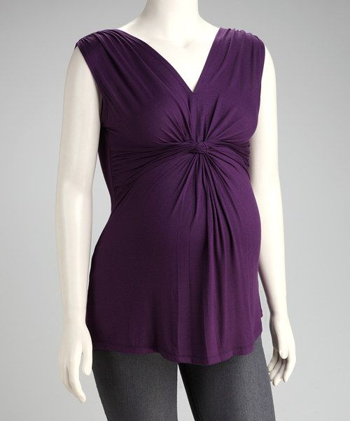 Fashionable colors and a knotted front make this top a figure-flattering favorite. Cozy fabric makes this piece the perfect companion to sunshine, chirping birds and blooming flowers.94% rayon / 6% spandexMachine wash; tumble dryMade in the USA