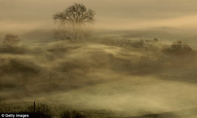 Atmospheric: Early risers in Glastonbury looked out on stunning scenes like this after this winter's unseasonably mild weather www.dailymail.co.uk