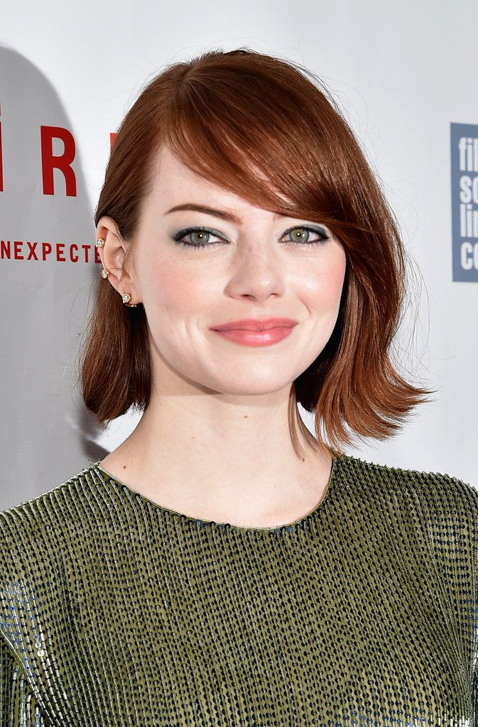 Emma Stone's rich auburn strands look especially stunning against a fair complexion.