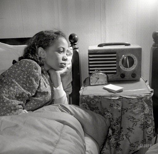 """Winter 1942. Washington, D.C. """"Young niece of Jewel Mazique, worker at the Library of Congress, who lives with her aunt."""" First in a series by John Collier for the Office of War Information."""