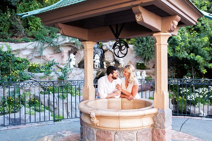 Newly engaged couple, Taylor and Thomas, enjoy each other's company at Snow White's Wishing Well in Disneyland