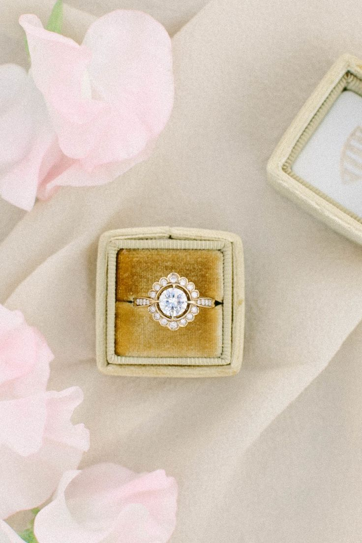 Round-cut diamond ring in halo setting: Photography: Jacqui Cole Photography - jacquicole.comRead More on SMP: http://www.stylemepretty.com/california-weddings/2017/05/05/inspiration-for-a-vibrant-palm-springs-affair/