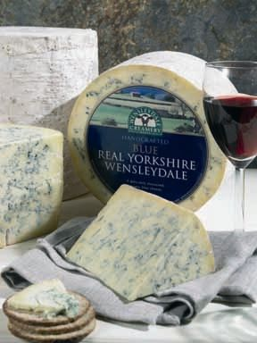 Blue Wensleydale cheese is handcrafted made in North Yorkshire, England. Made from cow's milk, and is a variation of Stilton cheese but more firm. It is matured six months and lightly pressed for only 24 hours before being wrapped in muslin cloth. It is a hard, blue-veined cheese, with a mellow and less salty taste appeals to newcomers and cheese connoisseurs.