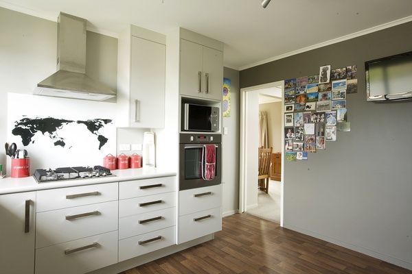 Never lose postcards and photos with Resene Magnetic Magic paint on the feature wall in grey/brown Resene Half Masala.