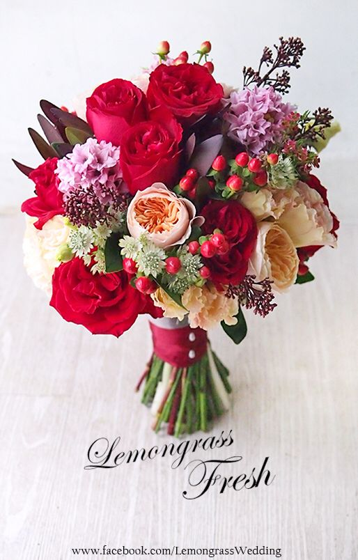 Wedding bouquet in red, lilac and peach