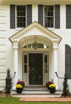 """Brick is Benjamin Moore """"Dune White"""" #968 Finish: low luster; Trim/Portico/Dormer= Ben Moore """"Brilliant White"""" #RME-01 finish soft gloss; Front door and shutters: Ben Moore """"Anchor Gray"""""""