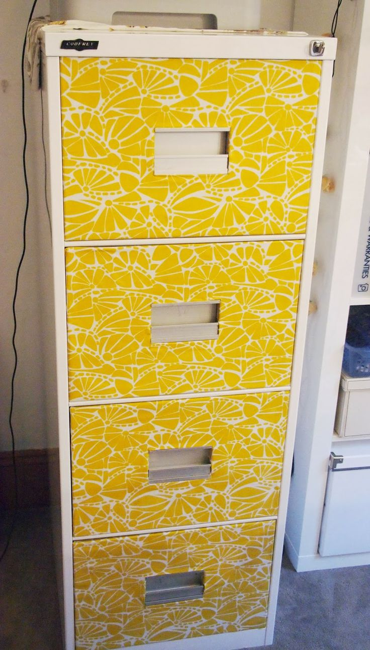 Pretty yellow and white decoupaged filing cabinet, via Pinterest