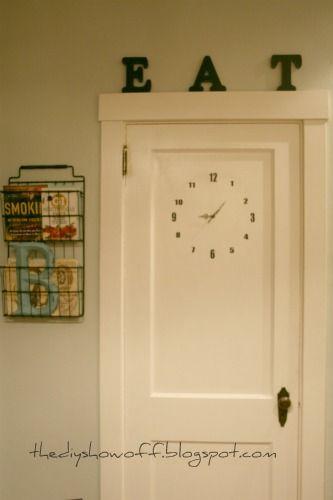I like the rack/basket NEXT to the door! DIY door clock