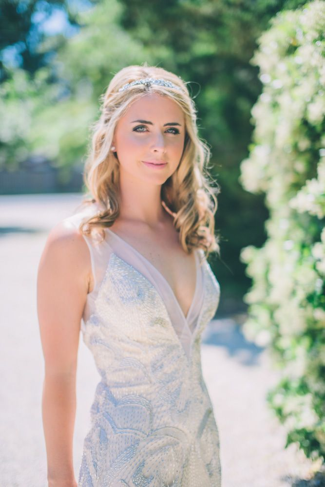 Wedding Hairstyle Ideas : Half-up style with lose curls and a silver headband for a boho touch