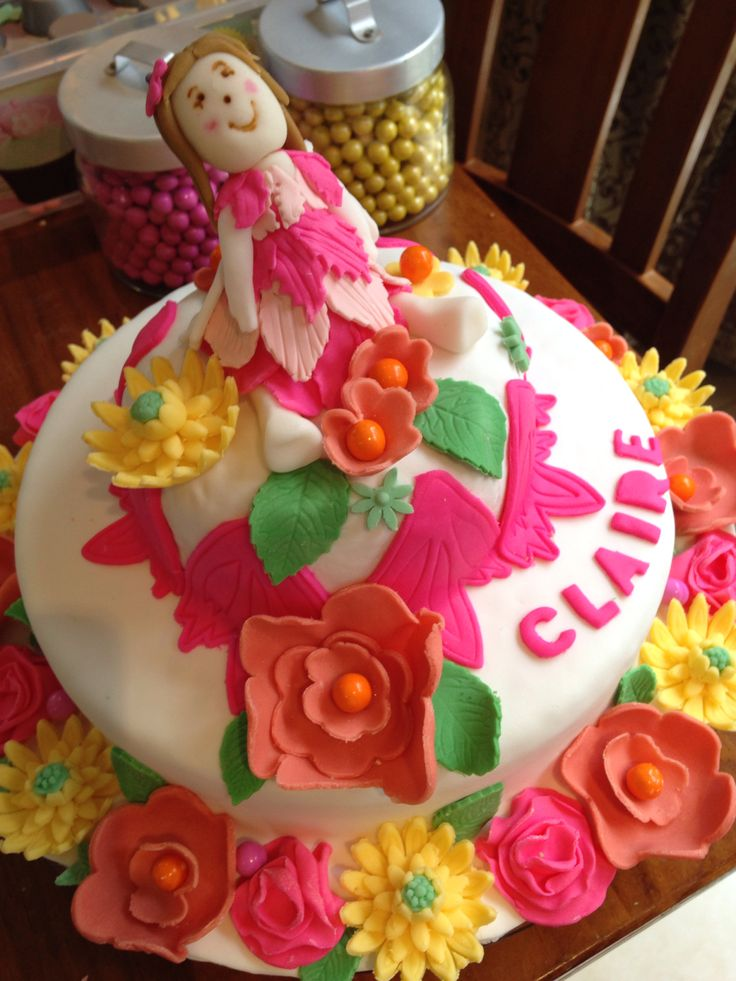 Fairy fondant cake in pink, orange, yellow and green madiera cake