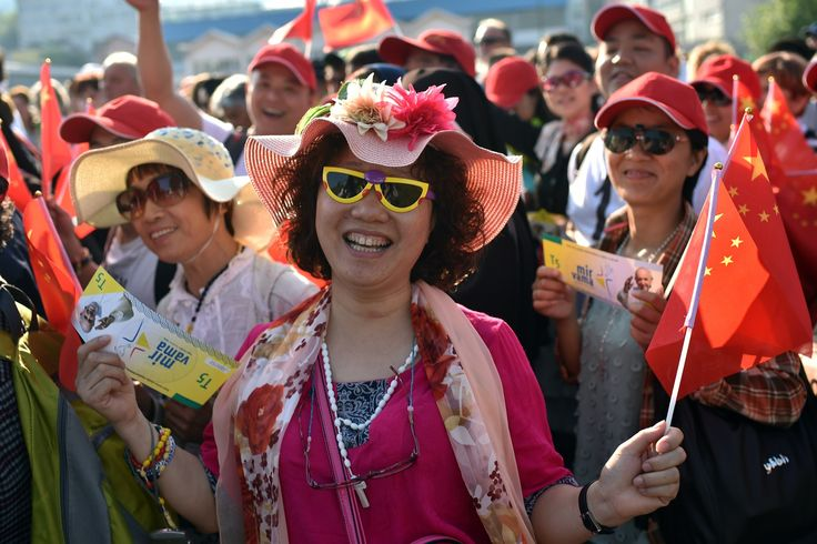Sarajevo, Bosnia Women hold Chinese flags as they wait for the arrival of Pope Francis to celebrate a mass in Sarajevo's stadium