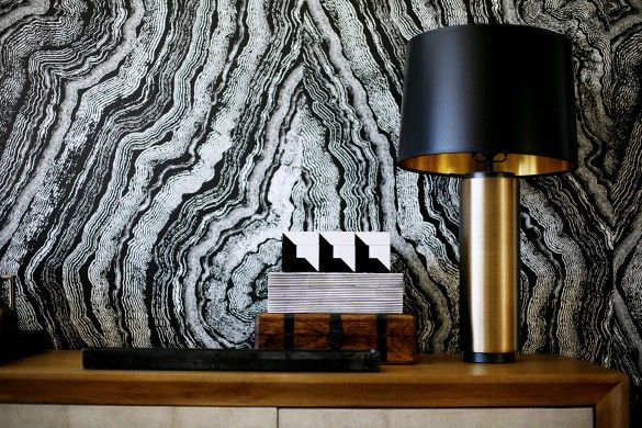 Agate print wallpaper with brass lamp
