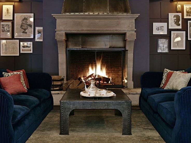 dark plush couch, industrial coffee table. dark walls Soho House Hôtel - Love the navy velvet sofas with the dark grey walls