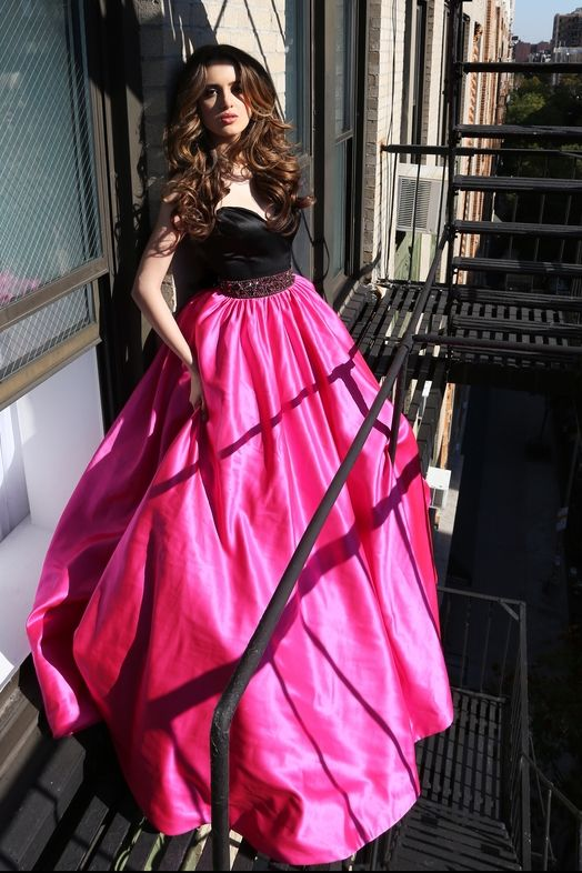 Laura Marano - This pink satin ball gown has set our hearts on fire, and there's no escaping its timeless beauty.
