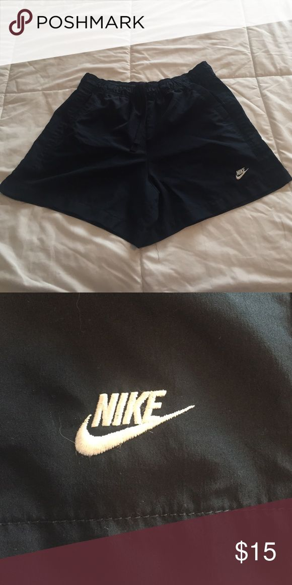 Black Nike shorts Black Nike shorts. White Nike logo bottom left side. Has pockets. In great condition! Nike Shorts