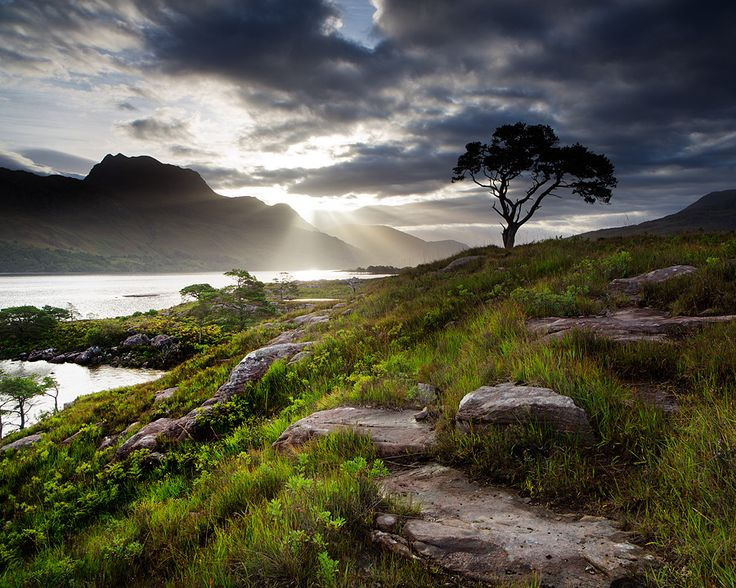 Loch Maree - a loch in Wester Ross in the northwest Highlands of Scotland. It was a sacred area to the early Celtics with Isle Maree, the sacred island of the Moon goddess in the lake and the sacred mountain Slioch near the shore. | by Stuart Low Photography