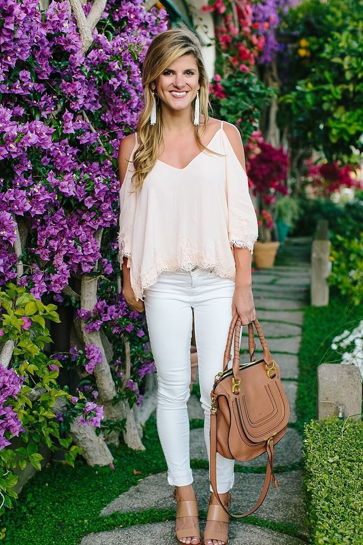 brighton keller at Il San Pietro di Positano pink cold shoulder top and white jeans with tory burch wedges