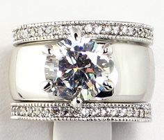 4.28 CT. Wide Solitaire CZ ETERNITY BAND Bridal Wedding 3 PC. Ring Set -i want my 2ct in this band :)