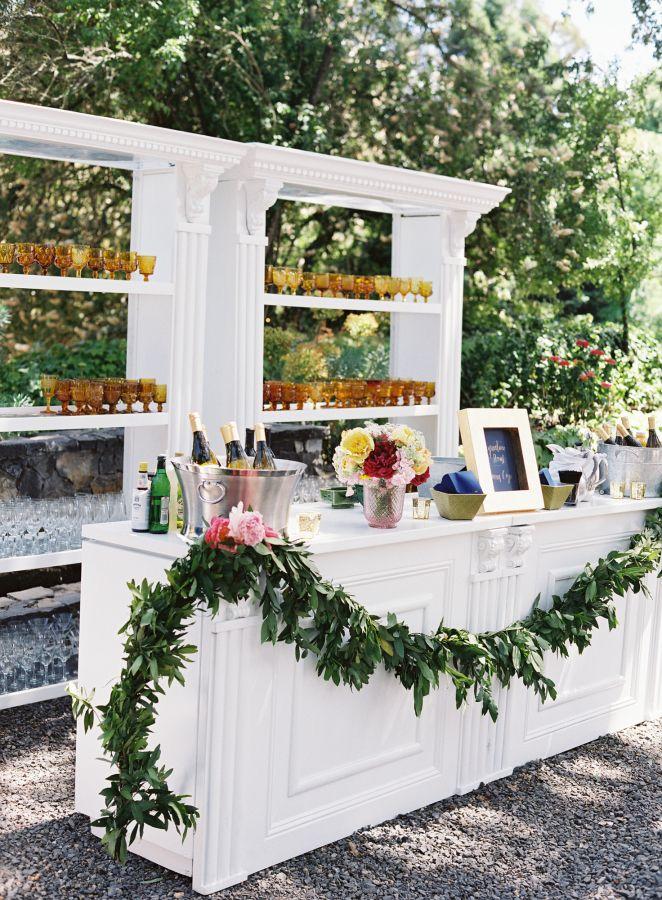 Gorgeous garden wedding bar: http://www.stylemepretty.com/2016/02/25/colorful-spring-garden-wedding-in-sonoma-valley/   Photography: Brett Heidebrecht - http://brettheidebrecht.com/